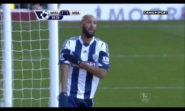 Anelka performs the controversial gesture after scoring against West Ham this afternoon. (Canal Plus Sport)
