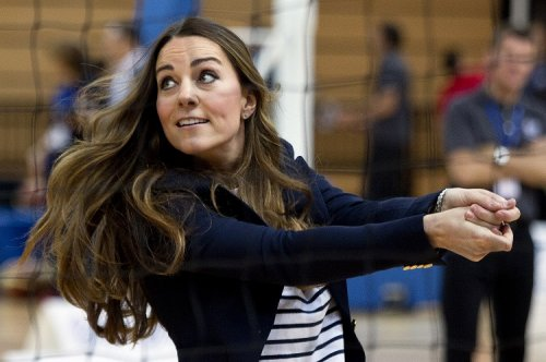Catherine, Duchess of Cambridge, plays volleyball as she attends a SportsAid athlete workshop at the Copper Box in the Olympic Park in London