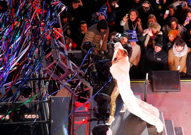 Miley Cyrus performs for revellers in Times Square during New Year's Eve celebrations in New York.