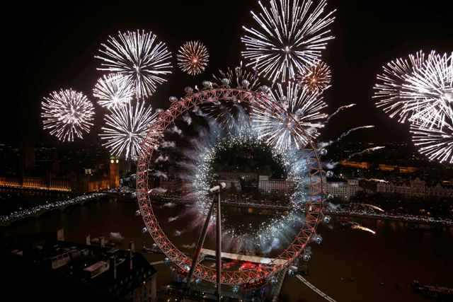 Fireworks explode across a London skyline near the London Eye during New Year celebrations in London.