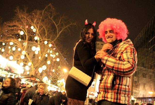 Revellers pose during New Year celebration time in Budapest.