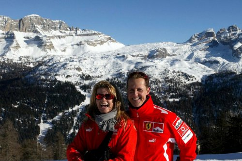 Michael Schumacher and his wife Corinna on the slopes at a mountainous resort