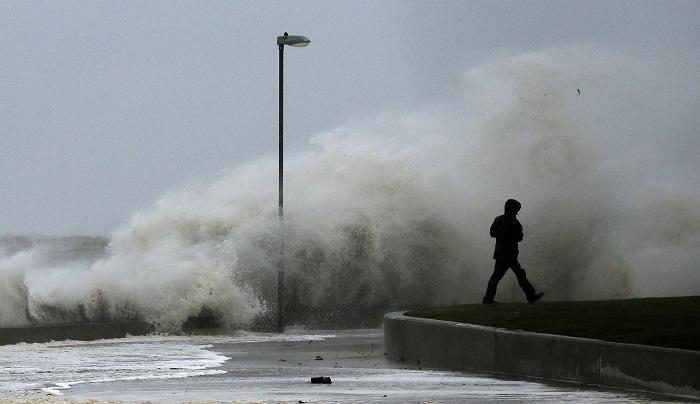 Tidal wave breaks on the promenade in Rhyl, north Wales.