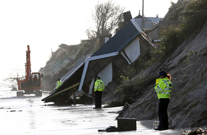Collapsed houses following a storm surge in Hemsby, eastern England.