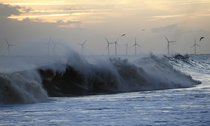 Massive waves crash onto the shore in the east of England.