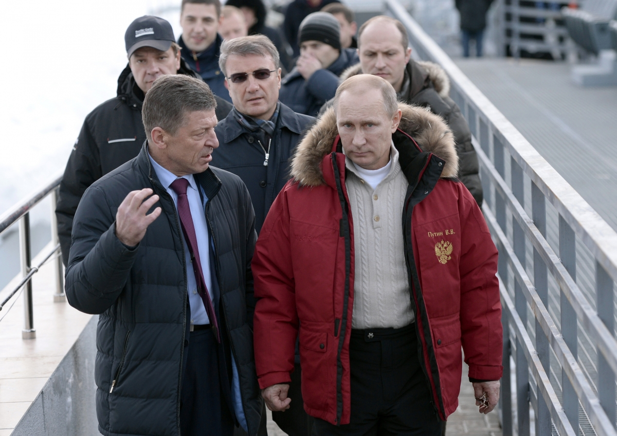 Russian President Vladimir Putin (R), Sberbank President German Gref (C) and Deputy Prime Minister Dmitry Kosak visit an Olympic venue near Sochi January 3, 2014.