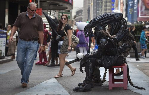 A character from the film Alien in Times Square, New York.