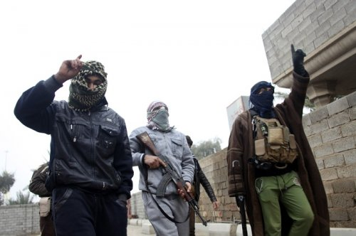 Al-Qaeda-linked fighters walk the streets of Fallujah in Iraq after claiming control from government forces.