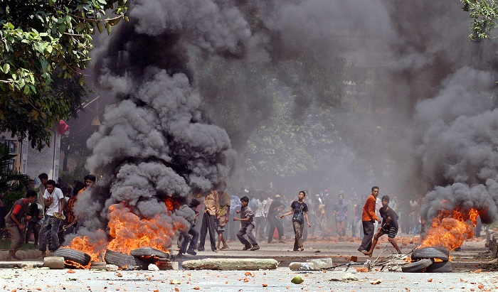 Residents of Dhaka's Mirpur district set fire to tyres amid anti-government protests in the city.