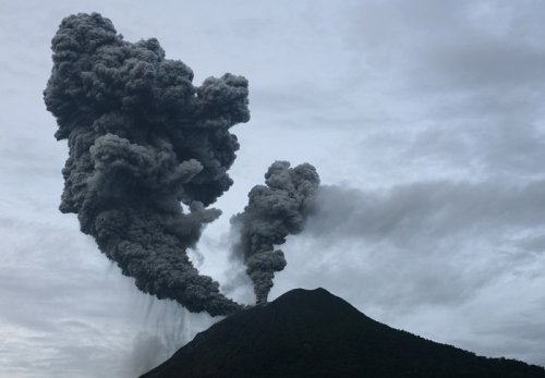 Mount Sinabung emits billowing clouds of smoke over Suka Nalu village in Indonesia's North Sumatra province.