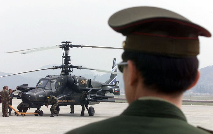 A Chinese officer looks on at a helicopter in the southern Chinese city of Zhuhai.