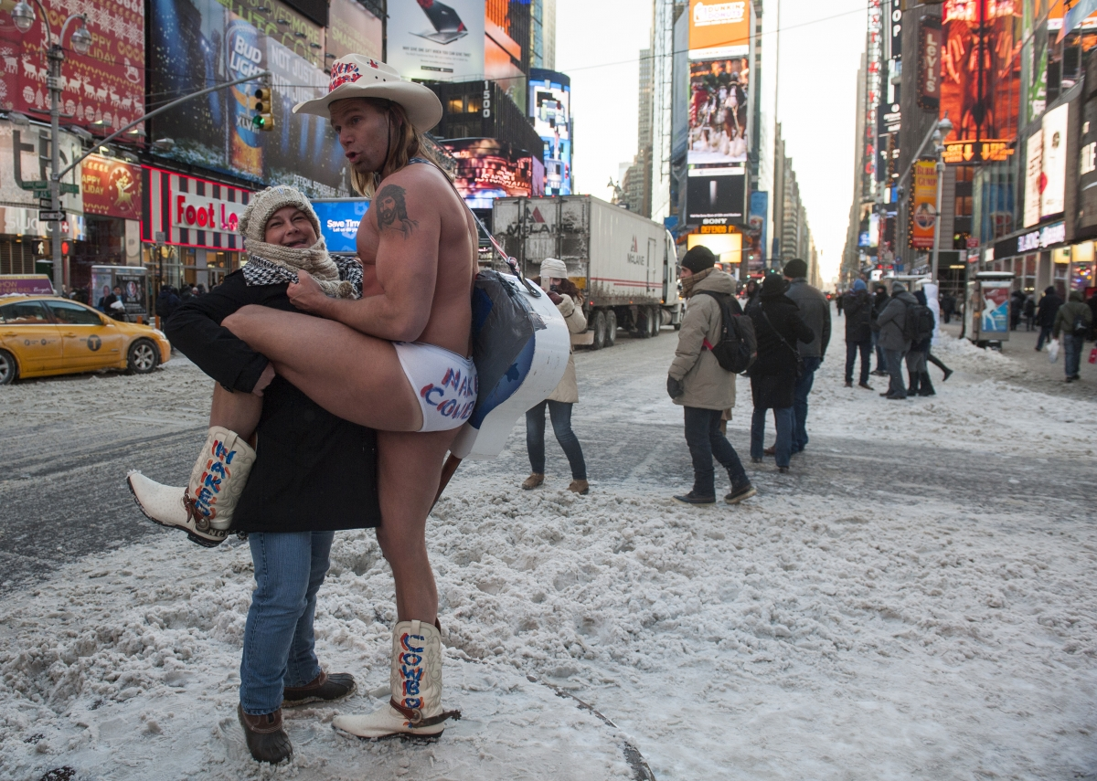 Robert Burck, the original 'Naked Cowboy', earns a good wage performing in Times Square in 1998. He claims to make up to 0,000 a year in tips.