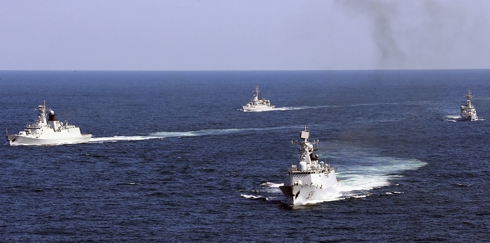 Chinese vessels patrol the East China Sea during a joint navy drill involving eight planes and over 1,000 military personnel.
