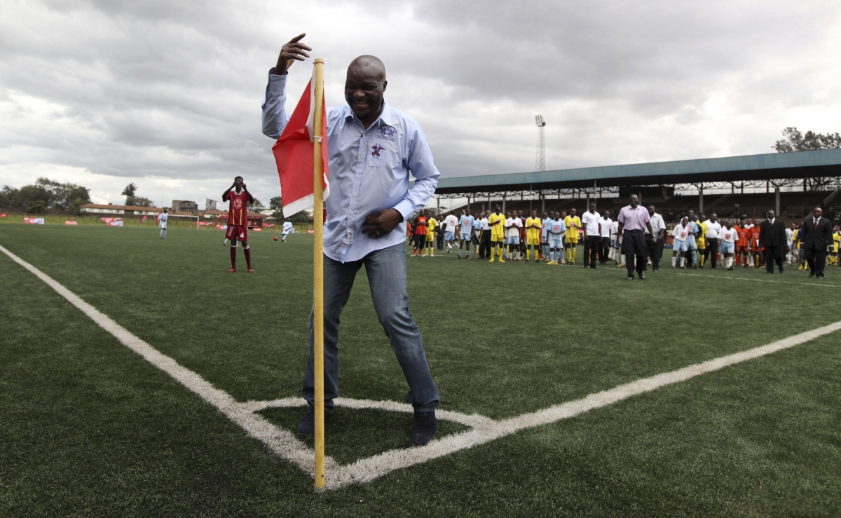 Former Cameroon player Roger Milla dances at the corner flag after meeting young Kenyan players in 2010.