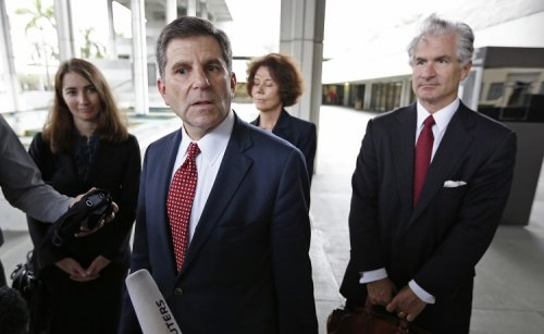 Attorney Aaron Marcu (2nd L) speaks about his client, Raoul Weil