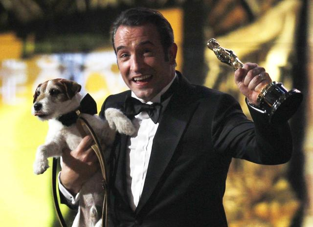 Jean Dujardin and Uggie celebrate The Artist win