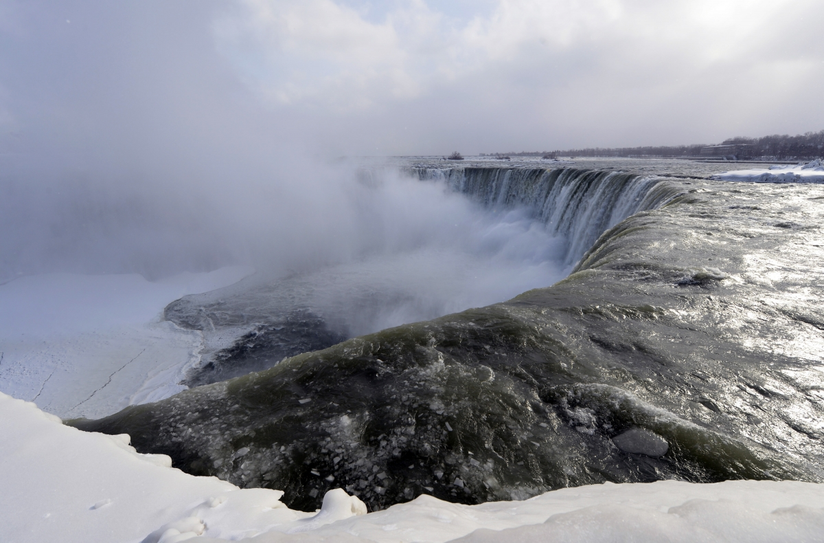 Ice chunks and water flow over the falls Niagara Falls, Ontario, January 8, 2014.