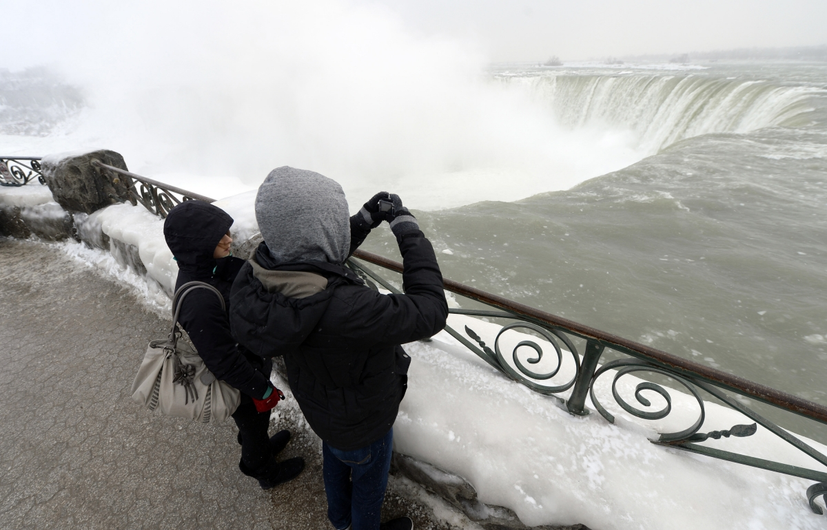 Visitors enjoy the frozen view of Niagara Falls in bitter cold.