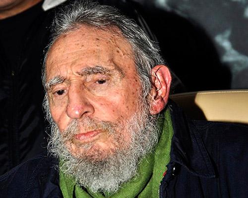 Cuba's former president Fidel Castro attends an art gallery in Havana