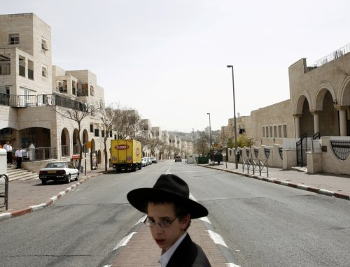 An ultra-Orthodox Jewish boy walks in Ramat Shlomo