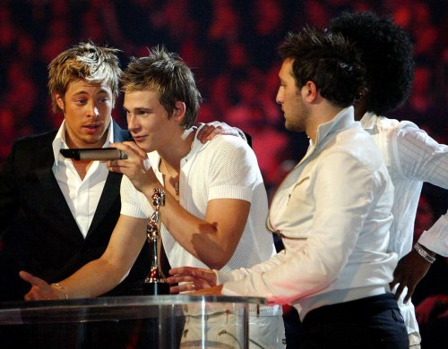 Lee Ryan, Duncan James and Anthony Costa from Blue