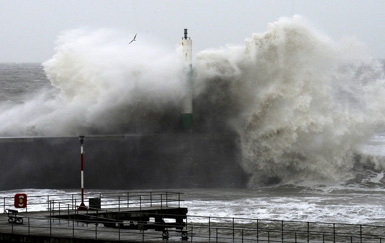 Large waves crash over the jetty at Aberystwyth