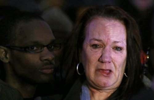 Pamela Duggan, the mother of Mark Duggan, weeps outside the High Court in London January 8, 2014.