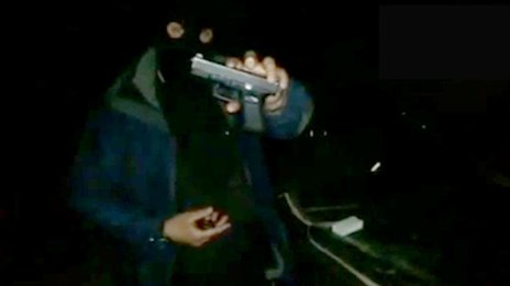 A British jihadist shows off his Glock pistol in a video posted on YouTube.