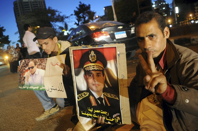 Egyptians hold pictures of Egypt's Army Chief General Abdel Fattah al-Sisi