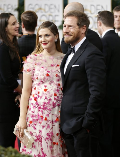 Actress Drew Barrymore and husband, Will Kopelman, arrive at the 71st annual Golden Globe Awards in Beverly Hills, California January 12, 2014.