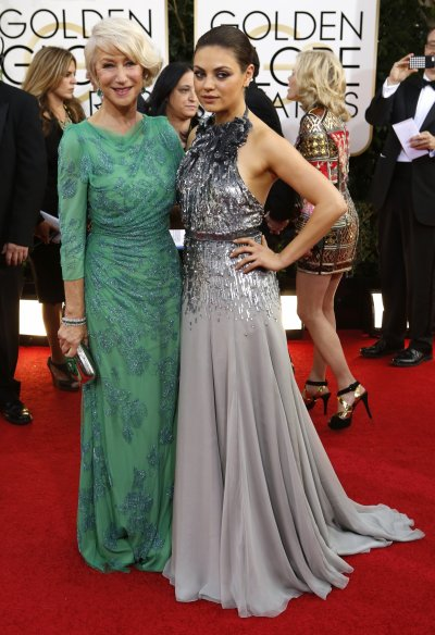Actresses Helen Mirren L and Mila Kunis pose on the red carpet of Golden Globes.