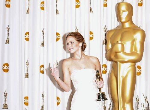Jennifer Lawrence flipped the bird at reporters after she fell up the stairs at last year's Academy Awards