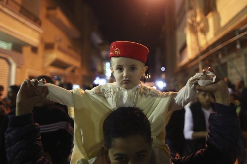 A child wearing a traditional costume takes part in a procession to celebrate the birth of Prophet Mohammad in Benghazi January 12, 2014.