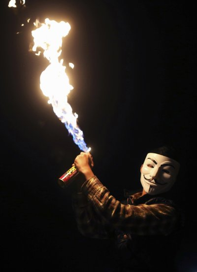 A boy wearing a Guy Fawkes mask celebrates the birth of Prophet Mohammad during a procession in Libya.