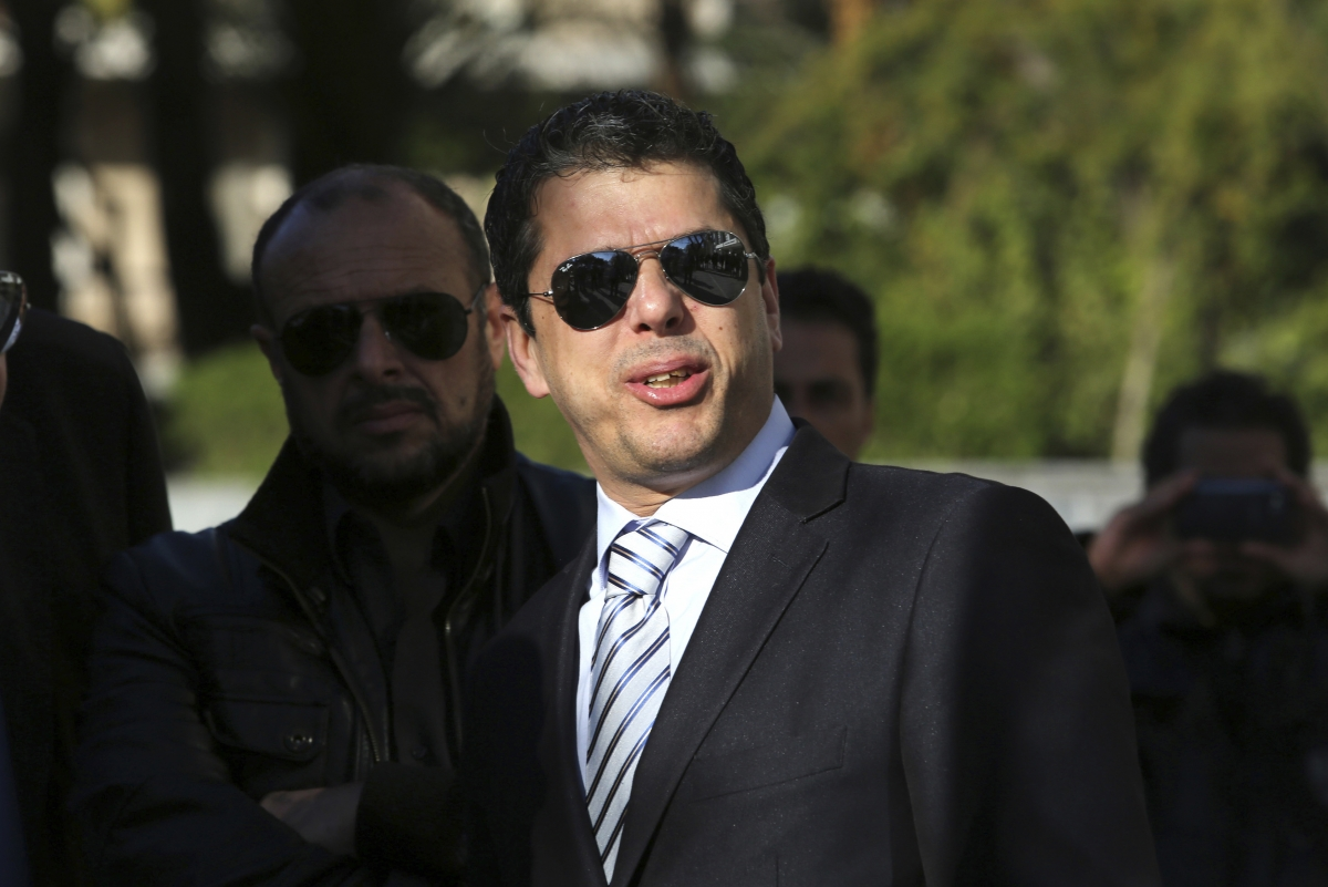 Extreme-right Golden Dawn party lawmaker Stathis Boukouras arrives at a courthouse in Athens