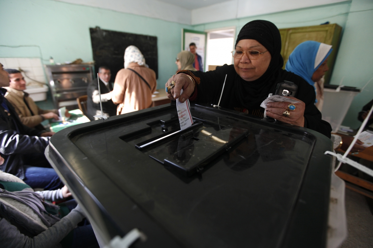 Women cast their votes at a polling centre during a referendum on Egypt's new constitution in Cairo