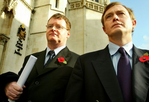 Britain's Sandy Mitchell (L) and Canada's Bill Sampson leave the High Court in London, October 28, 2004.