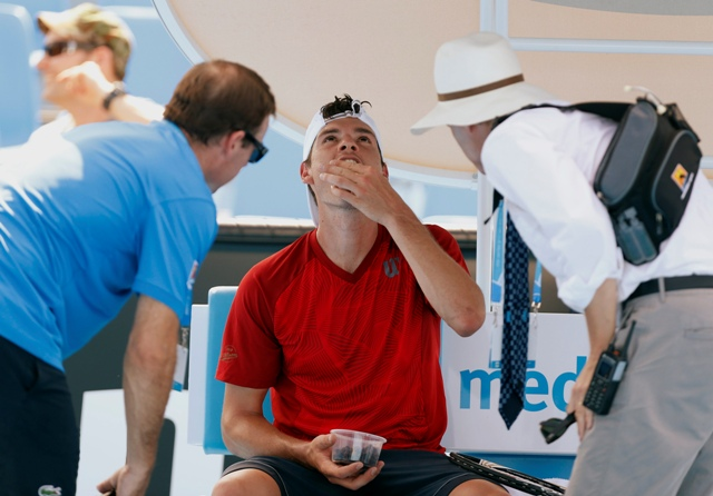 Frank Dancevic of Canada receives medical attention