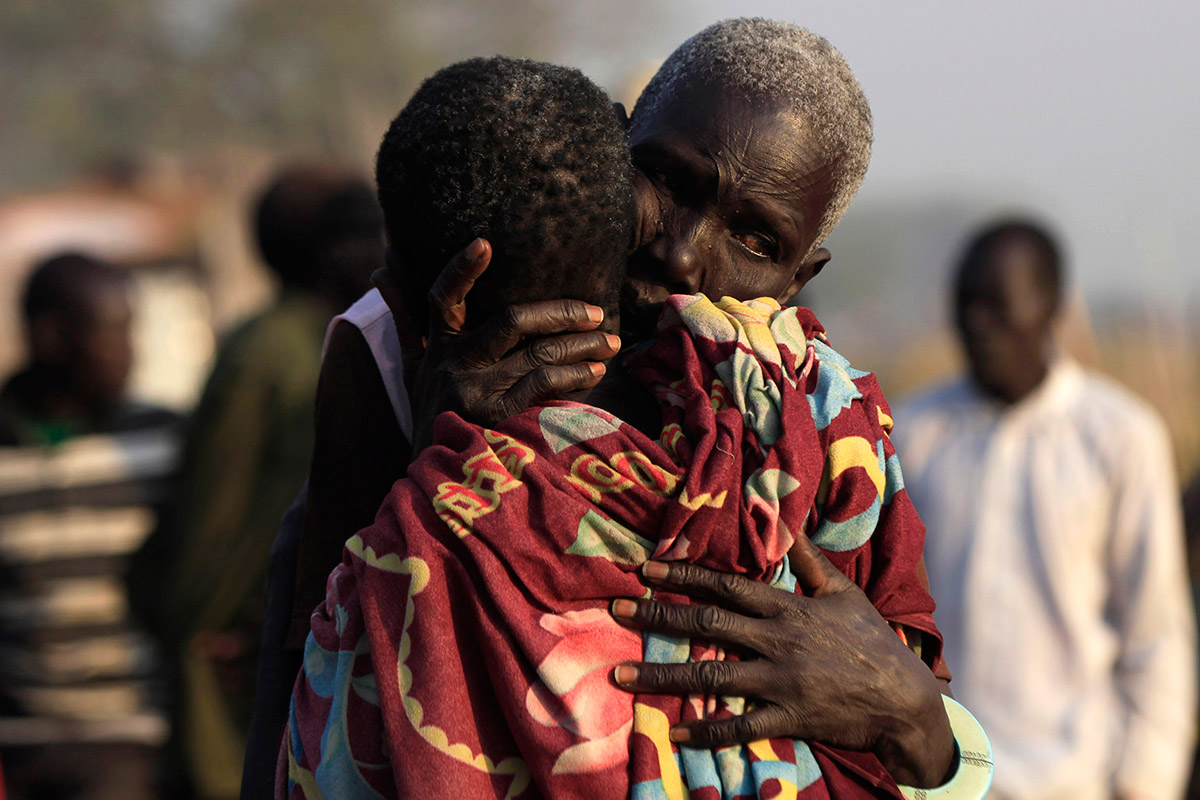 sudan women hug