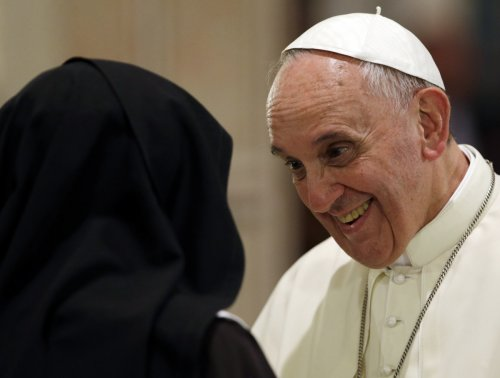 Pope Francis talks with nuns on a visit to Assisi, the Italian town that was home to his namesake St. Francis of Assisi.