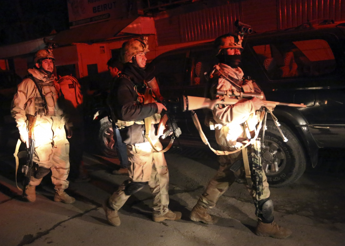 Afghan security forces arrive at the scene of an explosion in Kabul