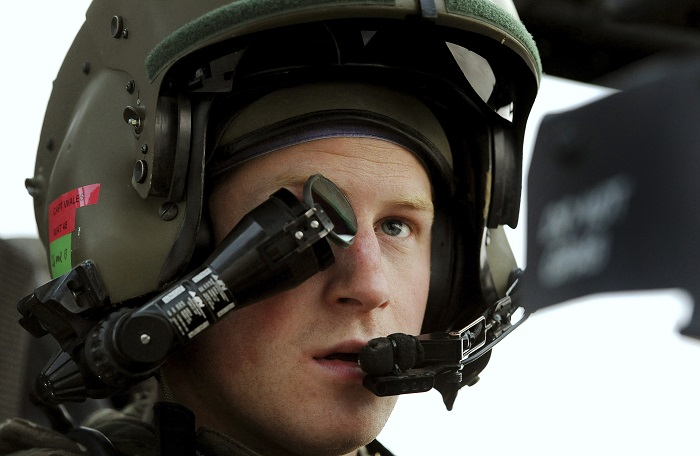 Harry sits in his Apache helicopter in Camp Bastion, southern Afghanistan.