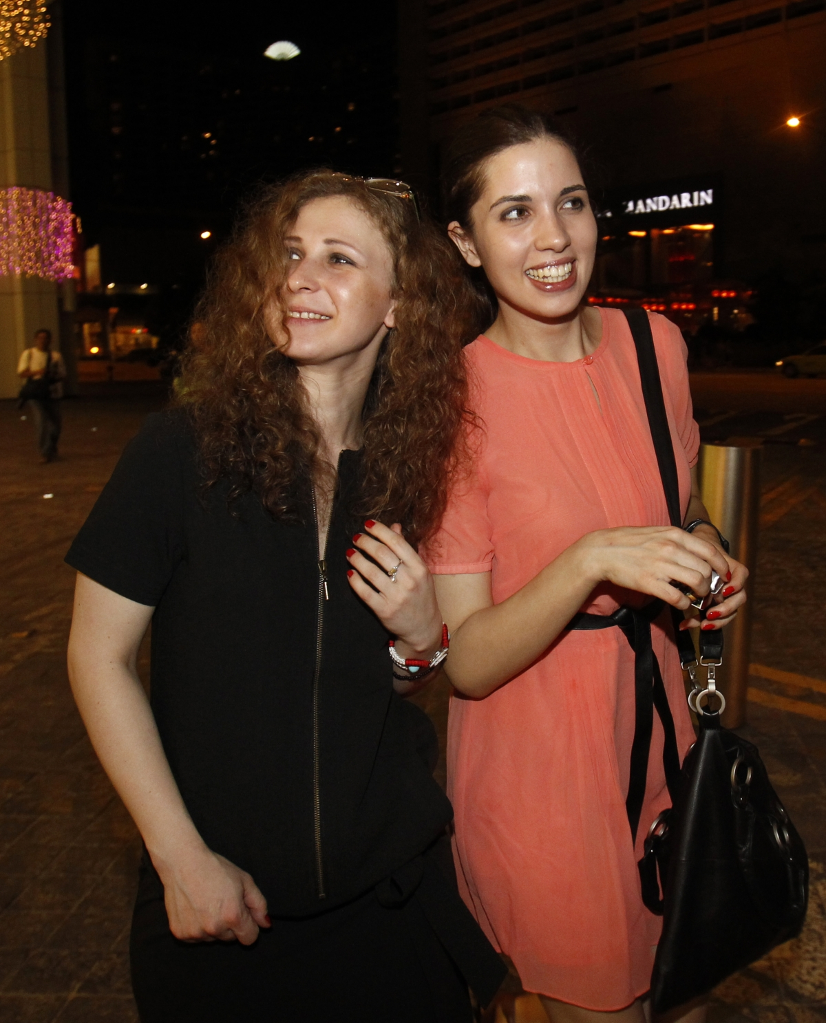 Members of Russian punk rock band Pussy Riot Nadezhda Tolokonnikova and Maria Alyokhina (L) arrive for the inaugural Prudential Eye Awards in Singapore
