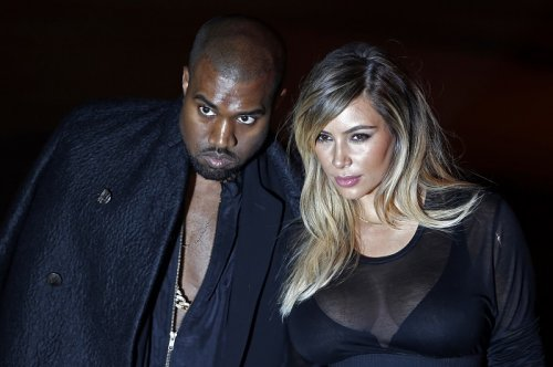 Kim Kardashian with fiancé Kanye West at the Givenchy Spring/Summer 2014 women's ready-to-wear fashion show during Paris Fashion Week.