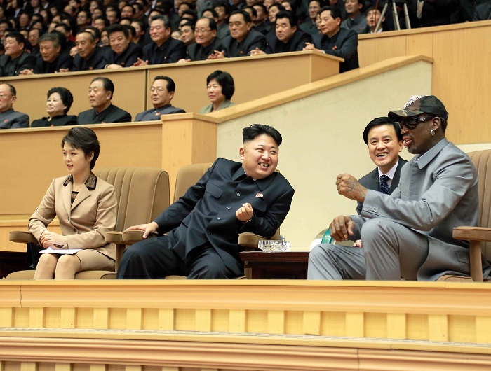 Dennis Rodman and North Korean dictator Kim Jong-un watch a basketball game at Pyongyang Indoor Stadium.