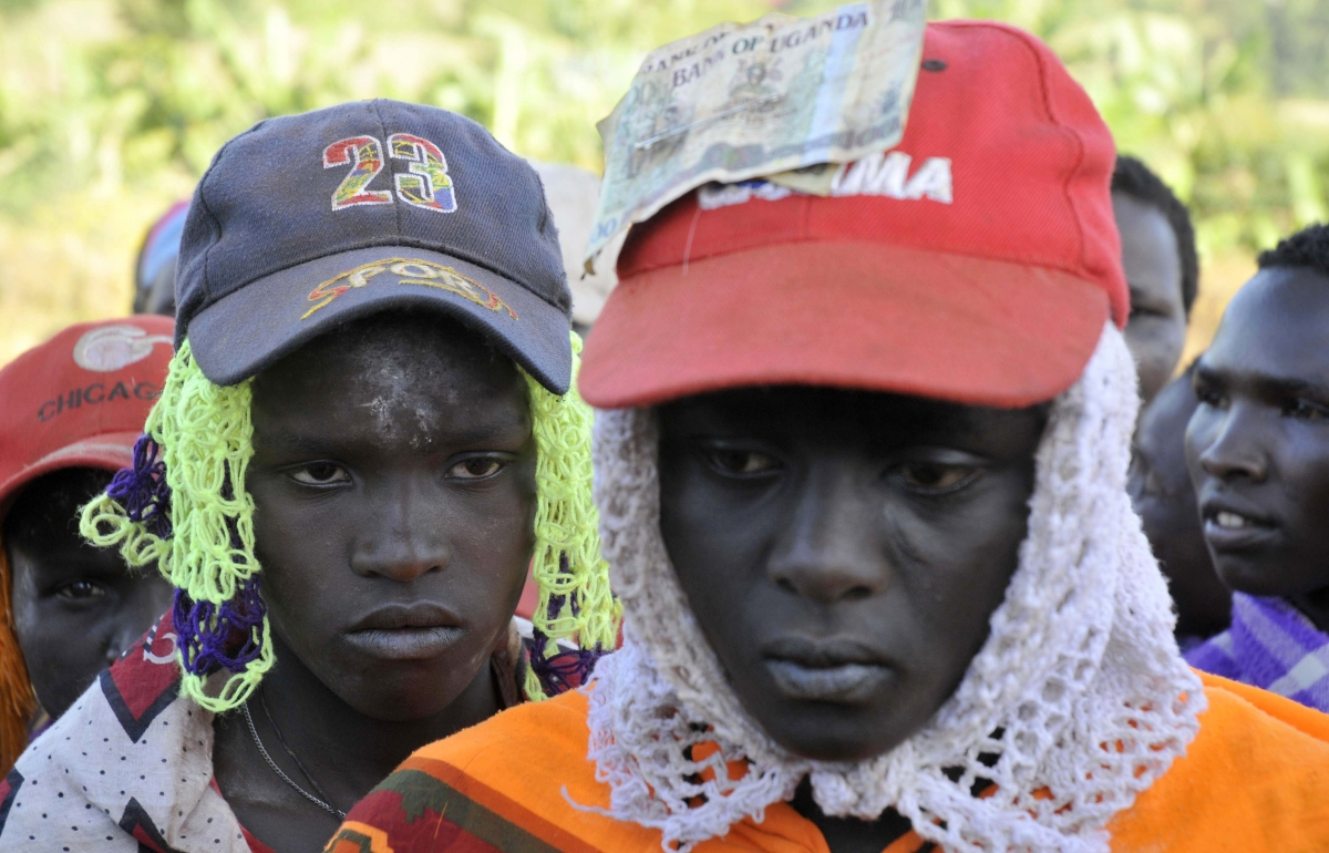 Teenage girls from Uganda's Sebei tribe queue before undergoing female genital mutilation in Uganda