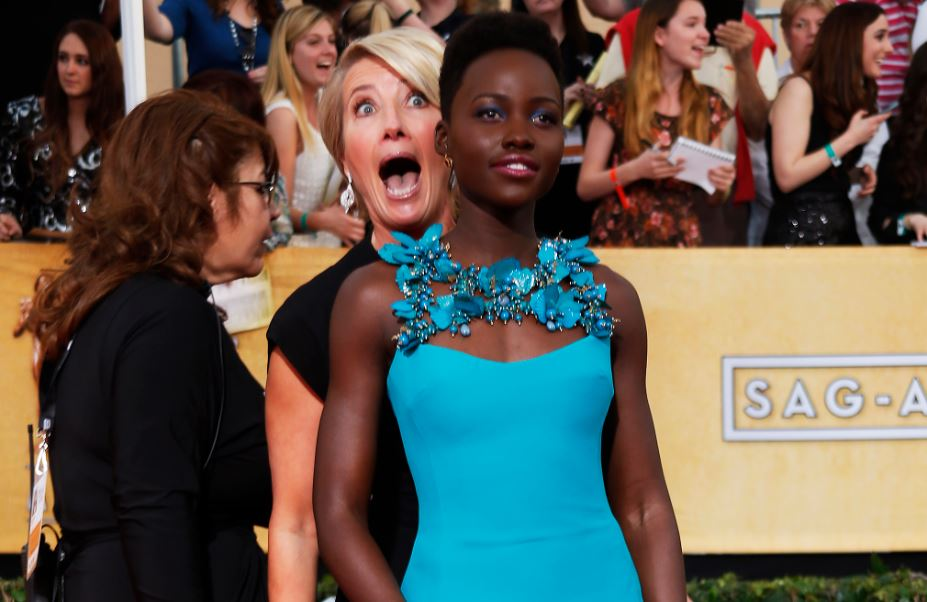 Actress Emma Thompson photobombed Kenyan actress Lupita Nyong'o as she hit the red carpet at the 20th annual Screen Actors Guild awards in Los Angeles, California.