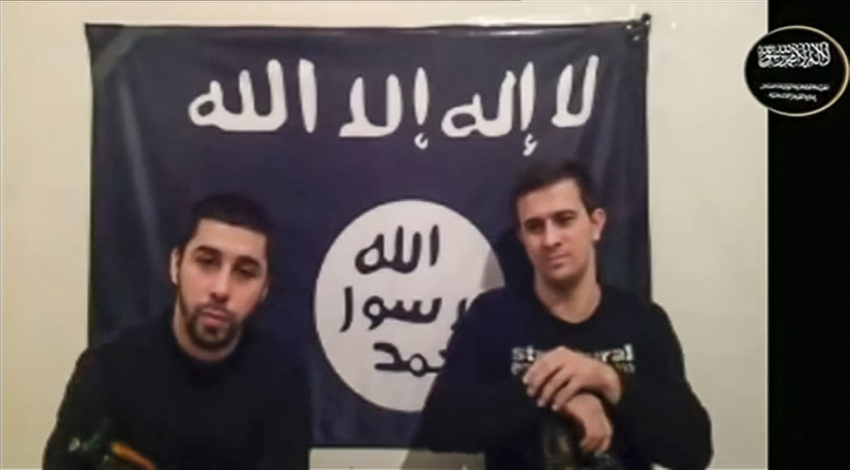 Men claiming to be from an Islamist militant group speak, in this still image taken from video footage posted on the Internet