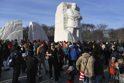 People visit the Martin Luther King Jr. Memorial on the U.S. national holiday in his honor, in Washington, January 20, 2014.