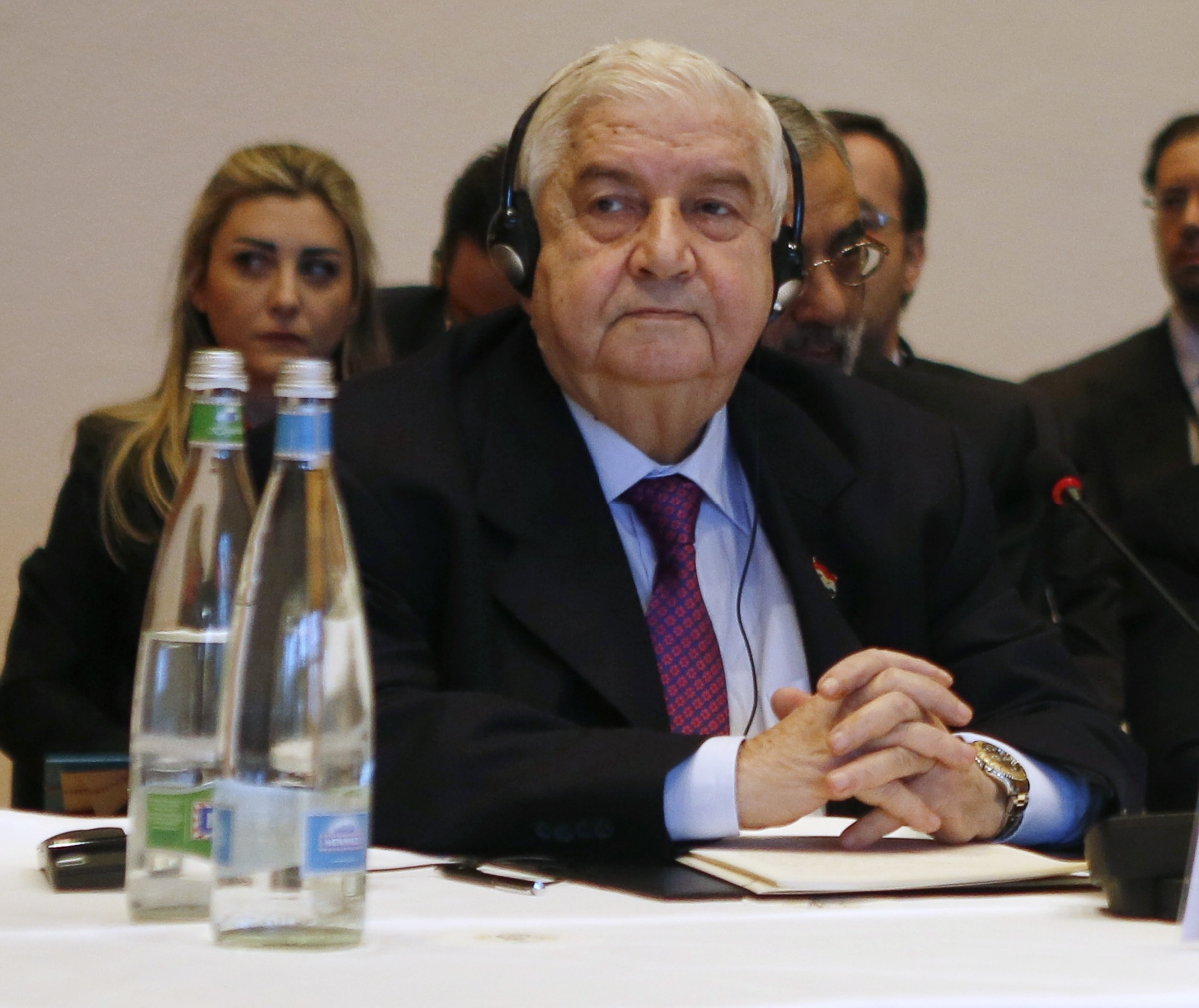 Syria's Foreign Minister Walid al-Moualem leads his delegation during a plenary session in Montreux